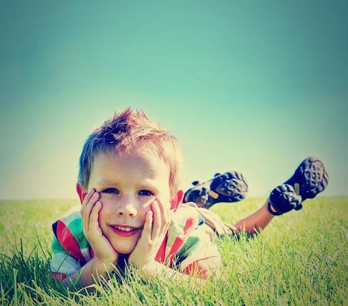 Pediatric Dentist in Santa Monica | Child in Grass