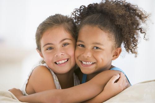 Two young girls hugging | Children's Dentist in Santa Monica